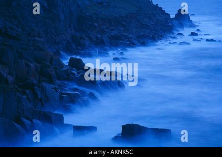 waves breaking on the rocks Porthguamon Cornwall England UK - Stock Photo