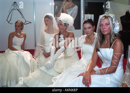 Young students dressed up as brides at a wedding fair in Poznan, Poland - Stock Photo