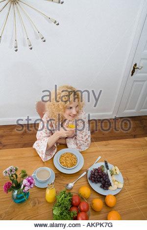 Woman having breakfast - Stock Photo