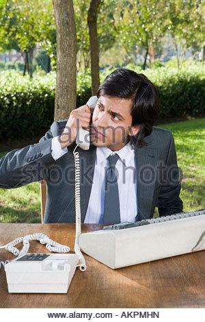 Businessman having a telephone conversation - Stock Photo