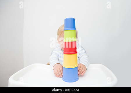 A baby boy playing with building blocks - Stock Photo