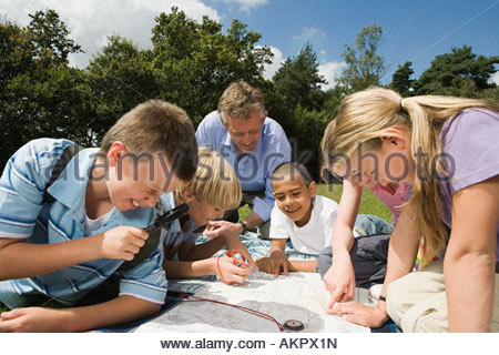 Teacher and pupils looking at map - Stock Photo