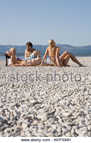 Friends on a beach - Stock Photo
