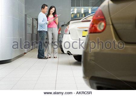 Couple in car showroom - Stock Photo