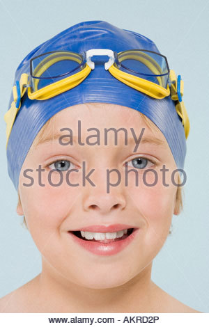Boy wearing swimming cap and goggles - Stock Photo