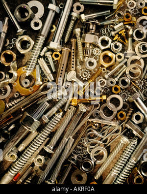 nuts bolts and industrial fasteners still life - Stock Photo