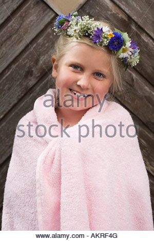 A girl wearing a garland of flowers - Stock Photo