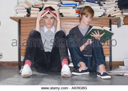 Teenagers reading books - Stock Photo