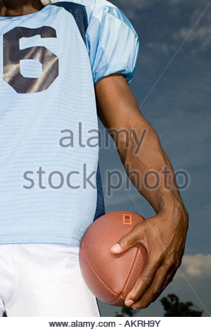 American football player with ball - Stock Photo