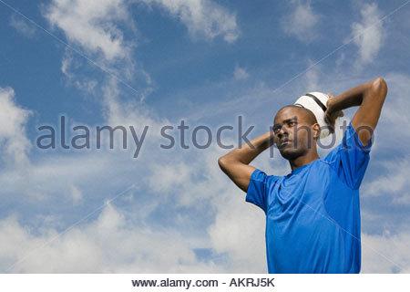 Footballer throwing a football in - Stock Photo