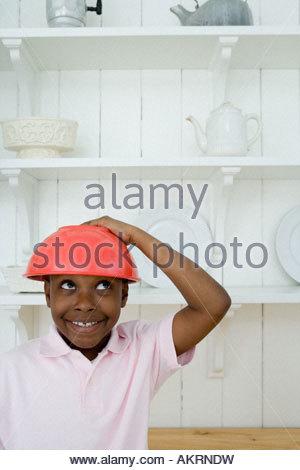 A boy wearing a bowl - Stock Photo