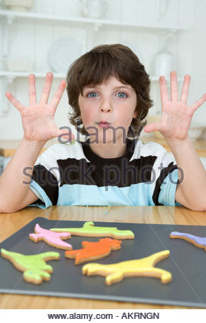 Boy with cookies - Stock Photo