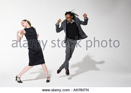 Two office workers dancing - Stock Photo