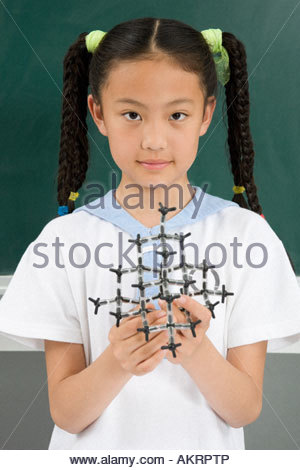 A girl holding a science model - Stock Photo