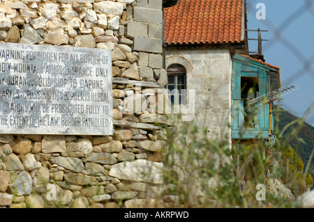 prohibition sign behind boarder fence of the mount Athos on the peninsula Chalkidiki Halkidiki Macedonia Greece - Stock Photo