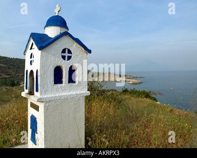 miniature church in Greece Sithonia Chalkidiki Halkidiki Macedonia in background fisher port of Sarti Mountain Arthos - Stock Photo