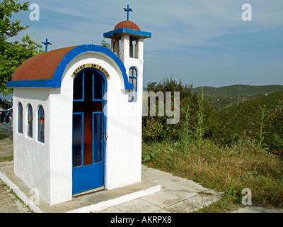 miniature church for praying in the landscape in Greece peninsula Halkidiki Chalkidiki Sithonia near by Kalimitsa - Stock Photo