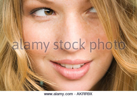 Young woman with freckles - Stock Photo