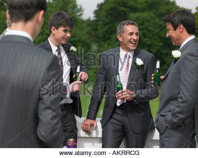 Groom best man and ushers talking - Stock Photo