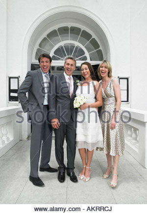 Portrait of bride groom best man and matron of honour - Stock Photo