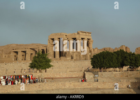 Kom Ombo Temple on the banks of the Nile dedicated to crocodile god Sobek and Horus the hawk god Egypt Bazaar in - Stock Photo
