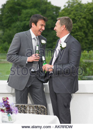Best man and the groom laughing - Stock Photo