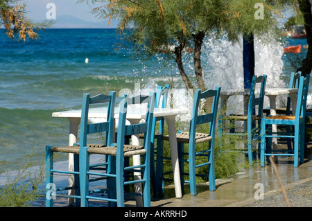 tables and chairs of a greek kafenion bar restaurant close by the sea stockfoto lizenzfreies. Black Bedroom Furniture Sets. Home Design Ideas