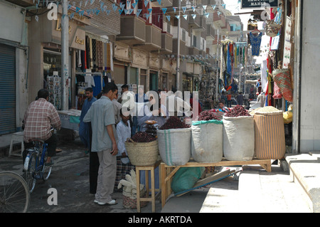Local Egyptian family buying food in the bazaar in Luxor Egypt - Stock Photo