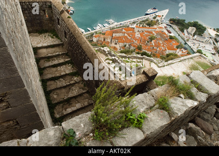 Looking down over Kotor town from the fortifications on the mountainside - Stock Photo