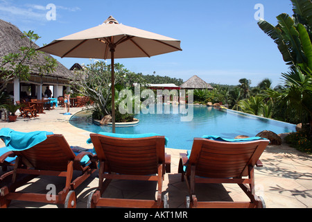 Landscape view of a swimming pool in a resort in Kovalam, Kerala - Stock Photo