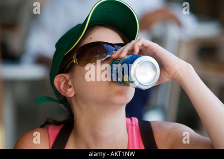 Young woman drinking a refreshing drink on a hot summer's day - Stock Photo