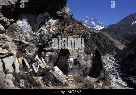 rock painting on Everest trail Solu Khumbu Nepal - Stock Photo
