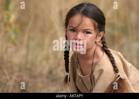 A green eyed young Native American Indian boy portrait - Stock Photo