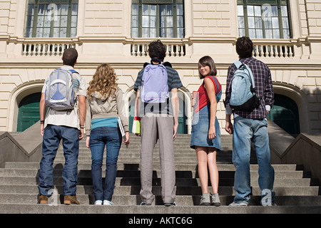 High school students standing on stairs - Stock Photo