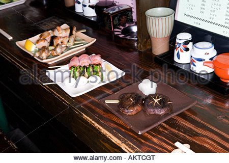 Yakitori on dishes in a restaurant - Stock Photo