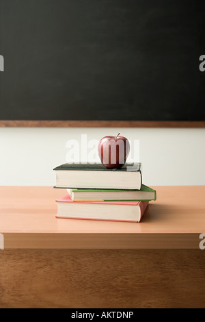 Apple on pile of books - Stock Photo