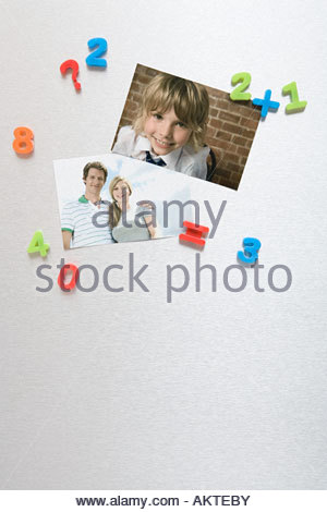 Photos on a fridge - Stock Photo