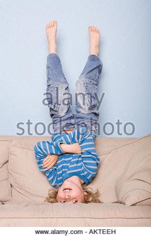 A boy upside down - Stock Photo