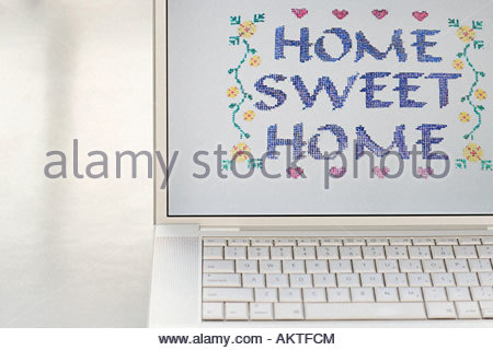 Home sweet home on a computer monitor - Stock Photo