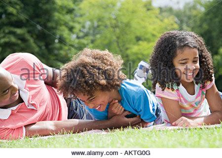 Family having fun in park - Stock Photo