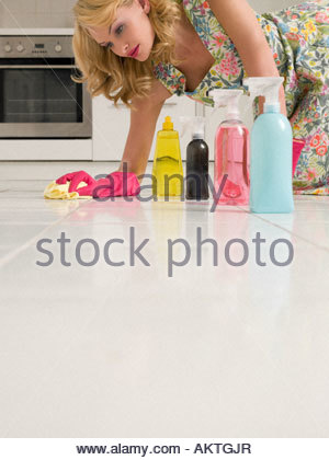 Housewife cleaning the kitchen floor - Stock Photo