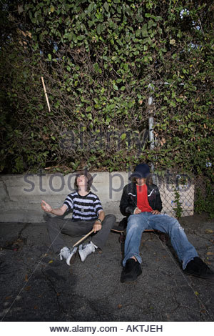 Boys sat in a street - Stock Photo