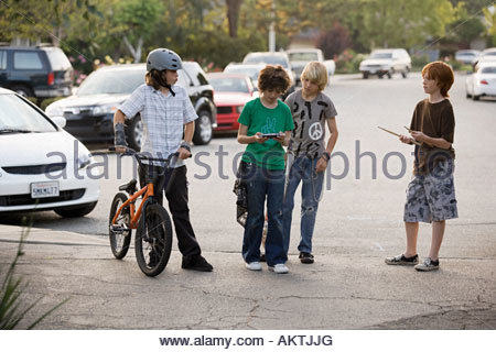 Friends standing in the street - Stock Photo