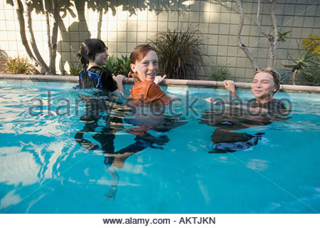 Friends in a swimming pool - Stock Photo