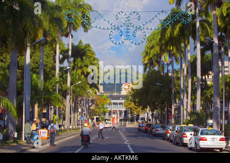 'Place d'Armes' leads to Statue of 'Queen Victoria' outside 'Government House' 'Port Louis' 'Mauritius' - Stock Photo