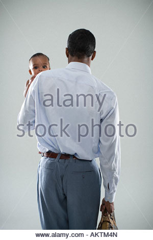 Businessman with baby - Stock Photo