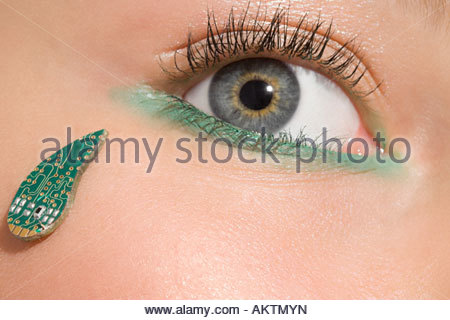 A womans eye and a circuit board teardrop - Stock Photo