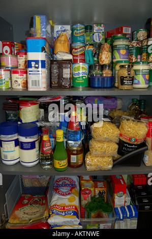 Well Stocked food cupboard or kitchen pantry - Stock Photo