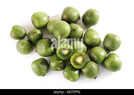 Whole and halved kiwi fruits, close-up - Stock Photo