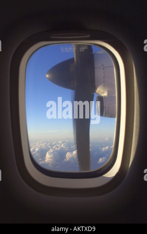 view through aircraft window while flying - Stock Photo